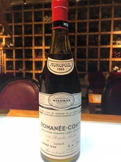 A bottle of wine  Description automatically generated with medium confidence