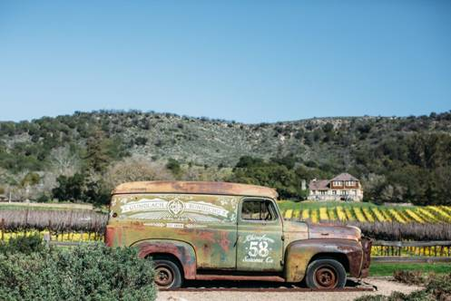 Old panel truck in front of vineyards